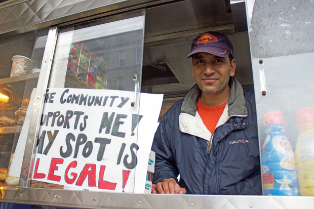 Sheref Abdelshafy in his coffee cart at 40th Street and Queens Boulevard.