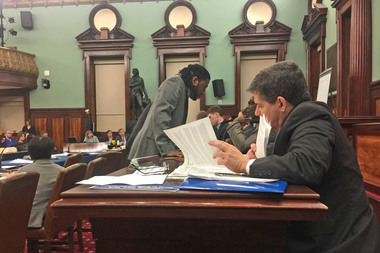 Councilman Jumaane Williams, left, consults with a colleague, while Councilman Vincent Gentile looks through paperwork at the City Council hearing on the mayor's controversial rezoning.
