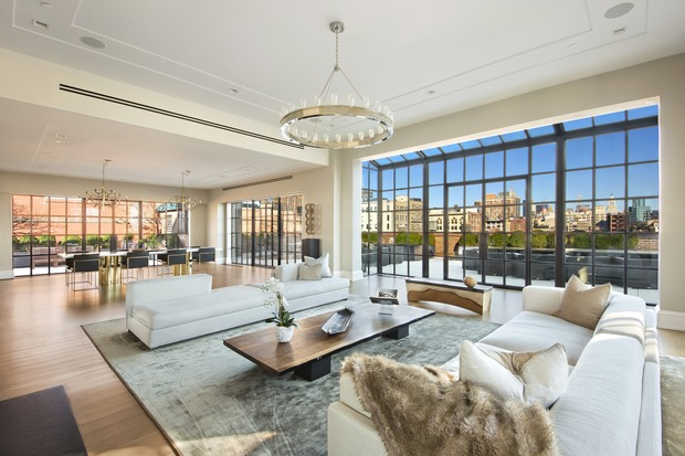 An image of a penthouse at 293 Lafayette St., a condo conversion of the upper floors of the Puck building, where penthouses are currently listed by Corcoran for $19.95 million and $58.5 million.