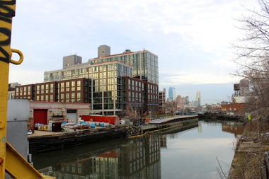 365 Bond St., the Lightstone Group's 430-unit rental building, seen from the Third Street bridge on the Gowanus Canal in March 2016. The development includes 86 affordable units and luxury amenities such as a yoga studio.