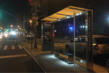 Solar-powered lights shine at a new bus shelter at Avenue C and East 16th Street, which had gone without lights since 2009.