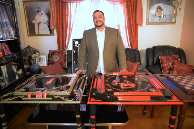 Rolando Prieto started his domino table business from the basement of his  family's home in Corona