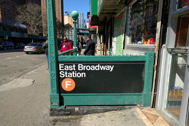A woman punched an MTA booth clerk in the face then maced her at the East Broadway station, police said.