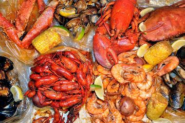 Hot N Juicy Crawfish will open its 11th location at 243 W. 14th St. in May, its co-founder said.