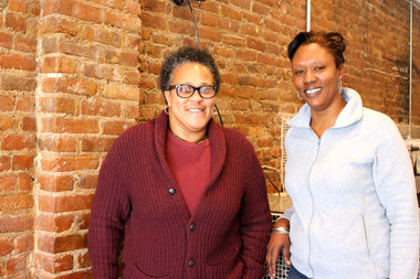 Rogenia Davis (left) and Melanie Graves-Singletary, owners of Ikhofi Cafe at 199 Malcolm X Blvd., are among several business owners setting up shop along the commercial corridor.