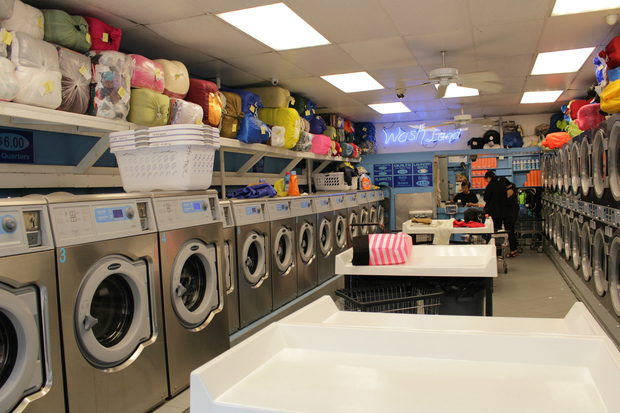 Patrons cleaning their clothes at a laundromat at Ninth Avenue between 52nd and 53rd Street.