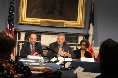 Mayor Bill de Blasio called on Gov. Andrew Cuomo and the state Senate to expand a rental assistance program to include victims of domestic violence at City Hall Wednesday. The mayor is flanked on the left by Steven Banks, commissioner of the Human Resources Administration and on the right by Dr. Herminia Palacio, deputy mayor for Health and Human Services.