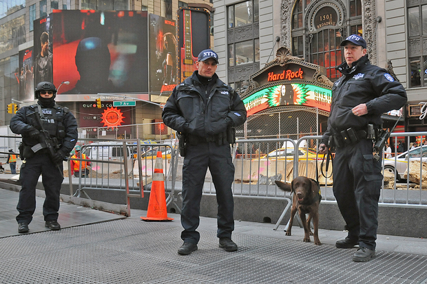 City officials believe only federal NYPD anti-terrorism is at risk by defying President Donald Trump's Executive order to cooperate with federal immigration authorities. Counterterrorism officers stand guard in Times Square after the attacks in Brussels Tuesday morning, March 22, 2016.