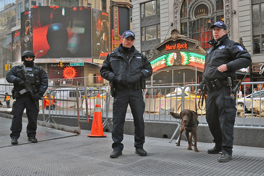 Counterterrorism officers stand guard in Times Square March 22, 2016 after attacks in Brussels.