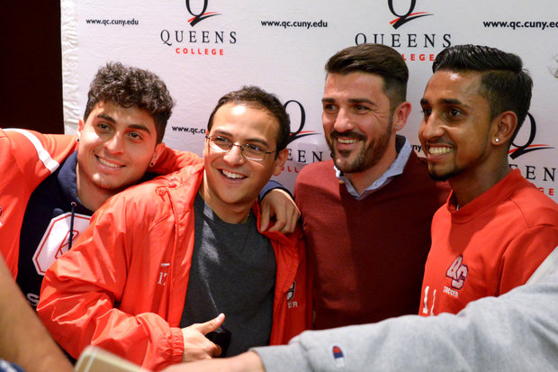 David Villa poses with Queens College soccer players and students.