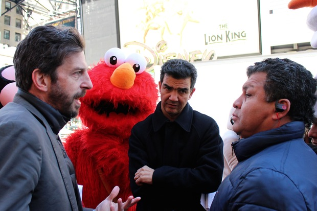 Officials meet with costumed characters prior to Times Square bill vote.