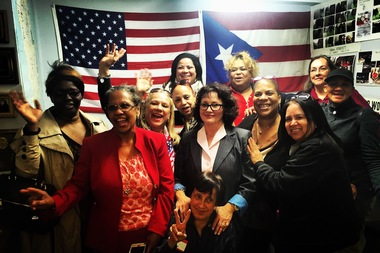 Alice Cancel, flanked by her supporters at the LES Democratic Club, celebrates her win.