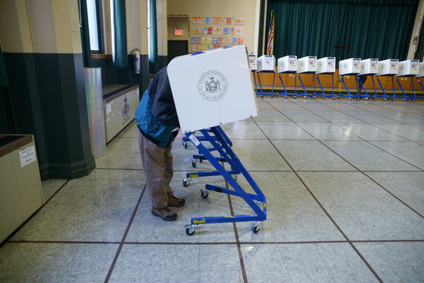 A man casts a ballot at St. Sebastian's school gym on primary day on April 19, 2016.