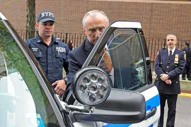Former Police Commissioner Bill Bratton inspects new bullet-resistant panels on an NYPD vehicle on Tuesday at NYPD headquarters, May 10, 2016.