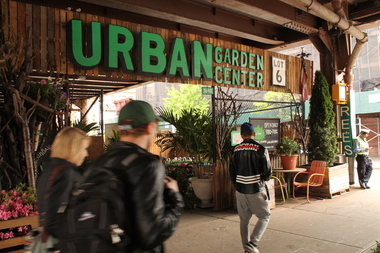 The entrance to the Urban Gardening Center on E. 116th Street in East Harlem. The business remained opened Wednesday after a massive blaze occurred Tuesday night under the tracks in East Harlem between East 117th and 118th streets, ruining their supplies. May 18, 2016.