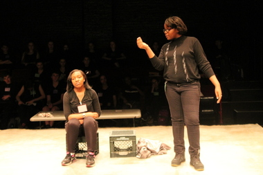 Eighth grader Taneyah Jolly and seventh grader Misa Smith, who took first place, act out a scene of Othello.