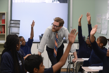 Sean Robertson, a history teacher at Harlem Academy, in his classroom at the East Harlem school.