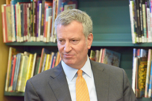 Mayor Bill de Blasio, seen here at the Woodside library, has come under federal scrutiny for his campaign finances.