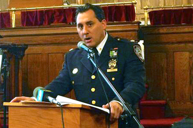 Deputy Inspector Michel Ameri, commanding officer of the 78th Precinct, speaks about street safety at a public forum in Park Slope on Dec. 3, 2013.