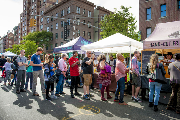 At the Chelsea Eats street fair in April, attendees wait in line for hand-cut fries.