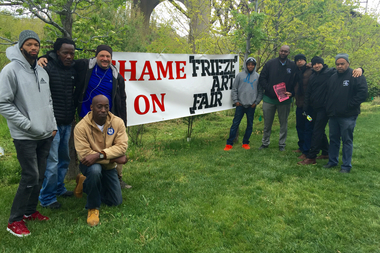 About a dozen of workers stand across from the Frieze Art Show to protest labor practices