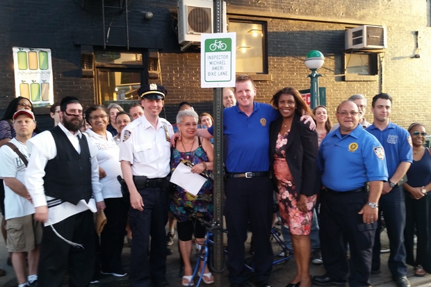 Officers with the 78th Precinct, local residents and street safety advocates gathered May 31 to name a bike lane on Bergen Street after NYPD Inspector Michael Ameri, the onetime 78th Precinct commanding officer who committed suicide on May 13.