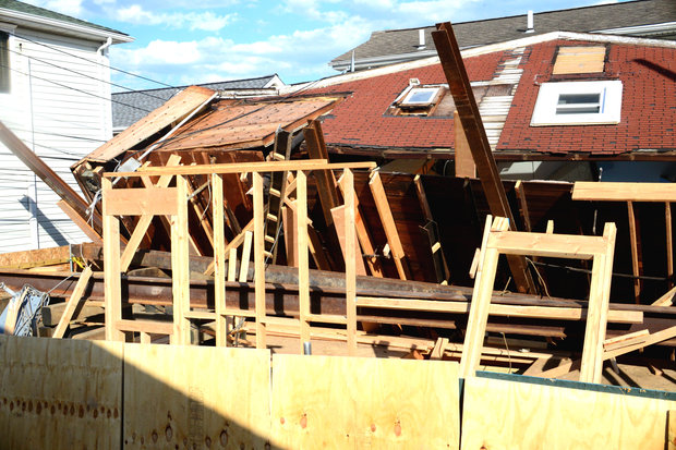 Sandy-Damaged Home Collapses After Being Raised Onto Stilts