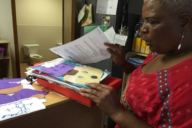Gail Davis shows a student's folder, which is one way to track a student's progress.