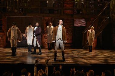 Lin-Manuel Miranda on stage as Hamilton