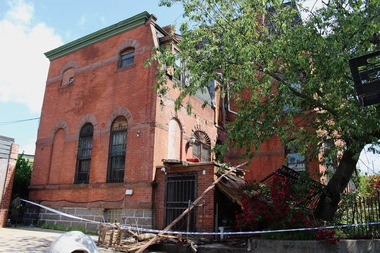 A second story balcony at the historic Cook Mansion collapsed Sunday morning with as many as 50 people on it, according to fire officials. Sixteen people were injured.