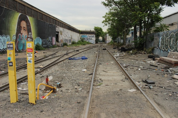 Open freight train tracks worry community members as the industrial park gets more bars and venues.