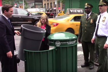Ben Kallos unveiled one of the new, larger trash bins at an intersection on East 86th Street on Friday.