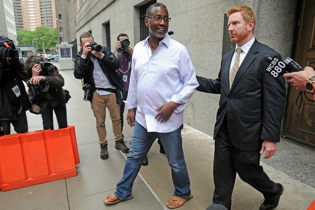 Correction Officers Benevolent Association Norman Seabrook, sporting flip-flops, smiles as he gets out of court after being arraigned on federal corruption and fraud charges.