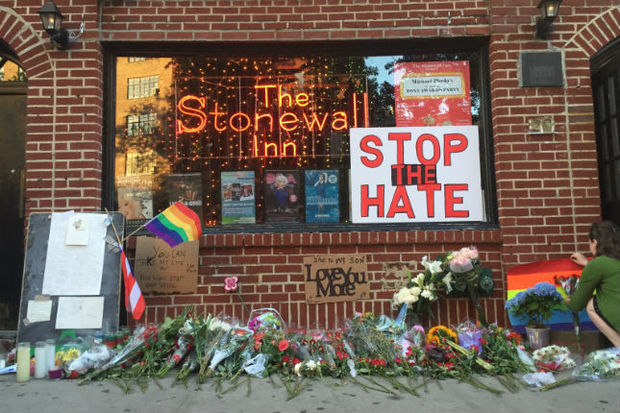 A makeshift memorial outside the Stonewall Inn during a vigil Sunday, June 12, to remember the victims of the Orlando, Fla., shooting that claimed 50 lives — the worst mass shooting in U.S. history.