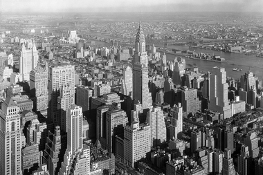The 1916 zoning resolution established limits on building heights to keep massive towers from casting shadows on all the street below. This led to the construction of tiered Art Deco skyscrapers, as seen in the photo above.