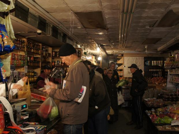 Shoppers crowded stores along Brighton Beach Avenue Wednesday despite flooding and continued blackouts.