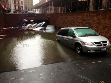 Cars sit partially submerged near 17 South William St. in Lower Manhattan on Oct. 30, 2012 after Hurricane Sandy.