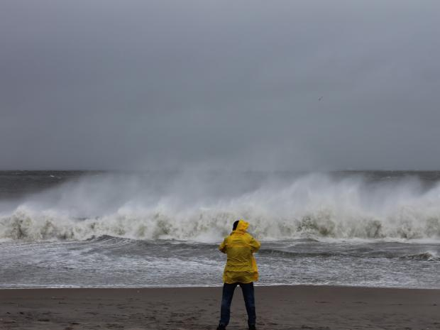 Thrill-seekers ignored police warnings to stay off the beach and boardway to get a close-up look at Hurricane Sandy.