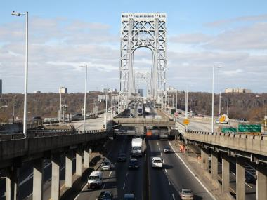 A man fell to his death after hanging from a George Washington Bridge railing Feb. 15, 2013, officials said.