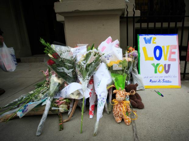 Flowers were left outside the Upper West Side apartment building where nanny Yoselyn Ortega allegedly killed two children Thursday, Oct. 25, 2012.