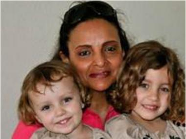 Yoselyn Ortega, 50, in an online photo of her with two of the Krim children, including Lulu, 6, (R), who police say she killed with a knife in the family's home on October 25, 2012. Nessie, 3, was with her mother and survived.