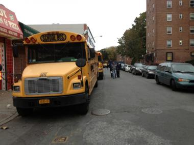Dozens of buses lined up outside the Red Hook Houses to transport residents to schools and shelters across the city