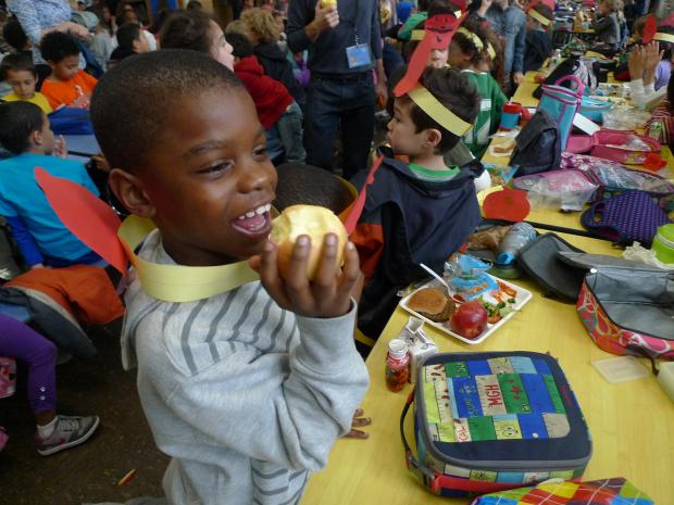 The school's 850 students — as well as parents, teachers and administrators — chowed down on an orchard's worth of apples Wednesday as they joined a citywide bid to set a world record for simultaneous apple consumption.   The city-sponsored apple eat-a-thon, called  Big Apple Crunch , was aimed at promoting healthy eating by staging dozens of mass apple crunchings across the five boroughs. It was part of a nationwide event called  Food Day .