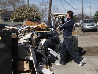A resident of Rockaway Park cleans out his flood damaged home on Nov. 5, 2012. The Department of Sanitation on Feb. 19 said they would extend their debris collection plan until further notice.