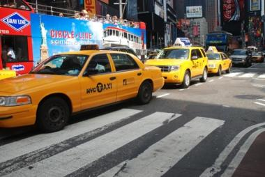 Cabs drive through Times Square.