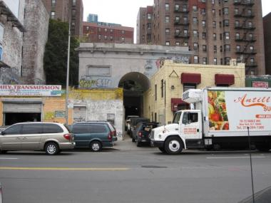 The Seaman-Drake Arch sits on a busy commercial strip on Broadway near W. 215th Street in Inwood. The arch is up for rent. Could it become a nightclub?