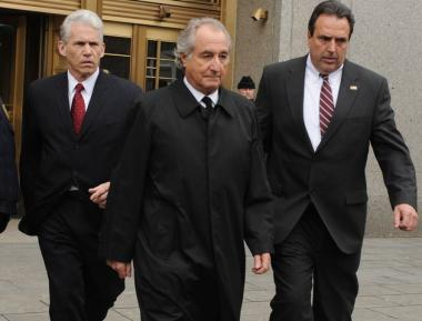 Bernard Madoff, in this March 10, 2009 file photo exits Manhattan federal court in New York. His daughter-in-law filed papers to change her last name as well as the last name of her kids.