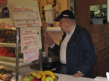 InHouse Nosh deli owner Andrew Spitz, 79, works the counter Nov. 24, 2009. Spitz