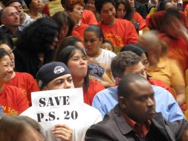 Shuang Wen students may have been spared, but parents at four other schools in District 1 are still angry over plans to expand a neighboring charter school into their classrooms. Parents, children, teachers and principals packed into P.S. 20's auditorium on Nov. 18, 2009 to protest the expansion.