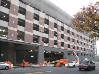 Costco construction plans were on hold until developers and the city agreed to have shoppers pay $4 for two hours of parking at the East River Plaza mall.